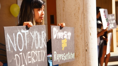 Victoria Huynh, co-leaderof the Students of Color Coalition, protests the Lions Roar admissions event on Nov. 9. PHOTO by Saanika Joshi
