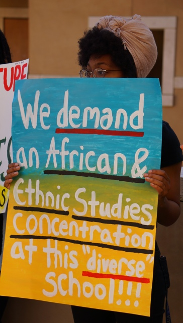 Kristen Storms, a leader in both Black Student Union and Students of Color Coalition, protests the Lions Roar admissions event on Nov. 9. PHOTO BY Saanika Joshi