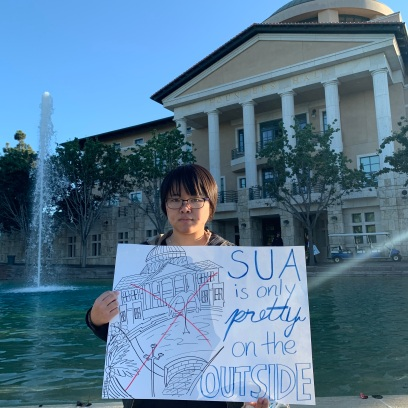 Nobuyo Guts Ogawa, class of 2020, protests the Lions Roar admissions event on Nov. 9. PHOTO BY Abbie Malabuyoc