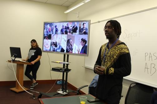 Malik Campbell, a CSUN student, presents